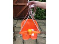 Child's swing seat with squeak button!