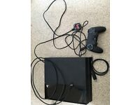 Sony Play Station 4 with 4 games
