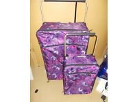 1 large suitcase and 1 hand luggage case