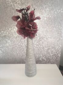 Glitter vase with red artificial flowers