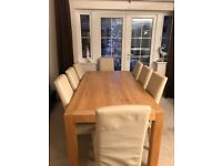Solid oak dining room table and 8 chairs with same design coffee table