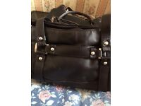 Black hand bag for every day use. Never been used with pockets medium size bag