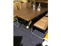 Brown modern extending table and six new leather chairs