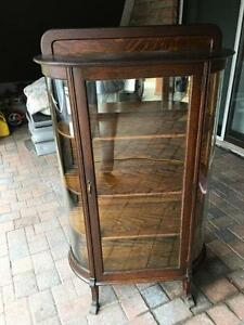 Antique Oak Curio Cabinet with Bow Glass