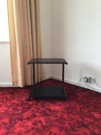 Small portable TV table on castors