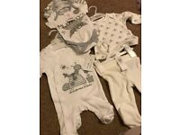 Unisex baby cloths brand new with tags, never been worn 0-3 months and newborn