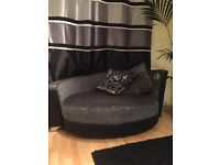 Black and grey sofa and large round snuggle chair