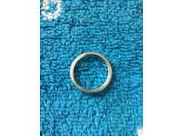 Silver ring with small diamond