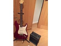 Excellent condition Encore electric guitar (red) with amp