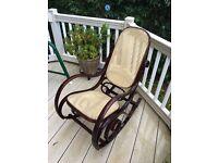 Rocking chair dark wooden vintage raffia covering
