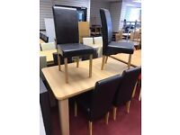Extendable Tale and 6 Black leather chairs