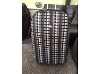 Large spotty suitcase