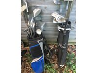 2 bags of golf clubs