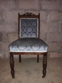 Antique chair with blue material seating