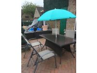 Garden table, chairs and parasol.