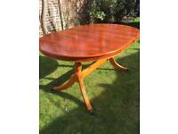 Solid Yew dining table extendable seats 6-8