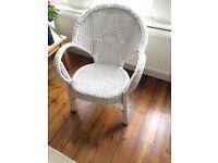 Elegant white wicker arm chair