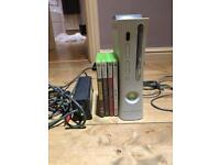 Xbox 360, cords with a few games. As seen.