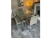 Extending glass and chrome dining table