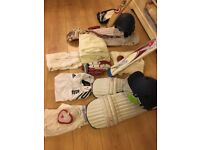 Cricket bags containing helmets, whites,bats,gloves,pads,protectors