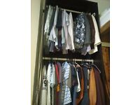 tall wardrobe with two clothes rails