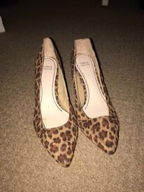 Marks and Spencer size 4 animal print heeled shoes. Size 4. Never worn. Excellent condition