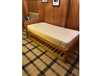 Single bed with guest bed trundle.
