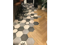 Floor tiles from Mandarin Stone - grey hexagon shaped