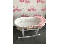 Moses basket along with a rocking stand
