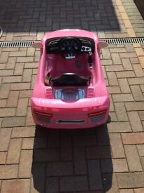 Pink ride on electric car