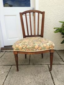 Antique style wooden chair with padded cushion