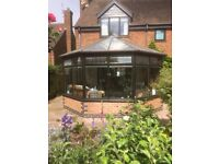 Conservatory. Used. (included: double french doors, double glazed windows, internal blinds)