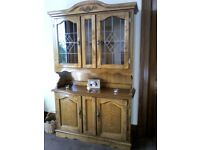 Solid wood dresser with lead glass and brass handles height is 78inches length is 4 foot depth 15 in