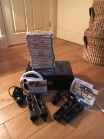 Wii 20 games 2 controllers handset charger steering wheel microphone 2 nunchucks