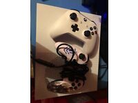 X box 1s two controllers and 6 games £250 Ono