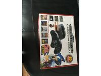 Sega mega drive with built in games and controllers