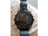 Genuine Diesel Watch. No box as used condition but it is in great condition. Sturdy strap!