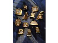 A selection of small metal clocks