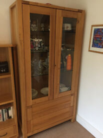 Glass-fronted oak cabinet