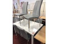 white gloss table and 6 grey leather chairs