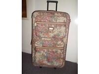 """Suitcase. Tapestry pattern 30"""" x 17"""" with 3 outside zip pockets."""