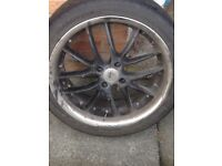 4 alloy rims back with silver trim 3 with tyres