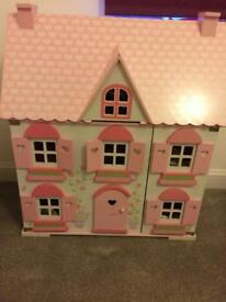 Lovely pink doll house