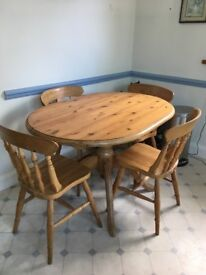 Oval pine kitchen table and 4 chairs