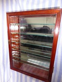 Collector's Display Cabinet, beautiful wood. Mirror-backed. Six glass shelves. Lockable with key.