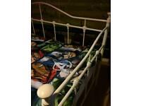 White single metal kids bed.