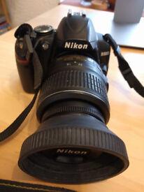 Nikon D3000 + Nikkor 18-55mm Lens