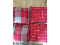 Checked feather-filled cushions