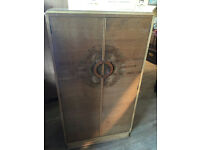 Vintage Gents Wardrobe - Art Deco Style . Has hanging space and shelved area . Free local delivery.