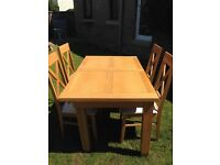 OAK DINING TABLE AND CHAIRS (GILLIES DUNDEE)
